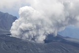 An aerial view shows an eruption of white smoke plumes above Mount Aso in Aso, Kumamoto prefecture,