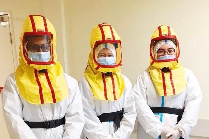 Three Muslim doctors in full PPE.