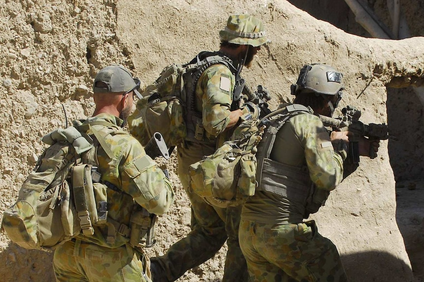 Australian special forces soldiers clear a compound