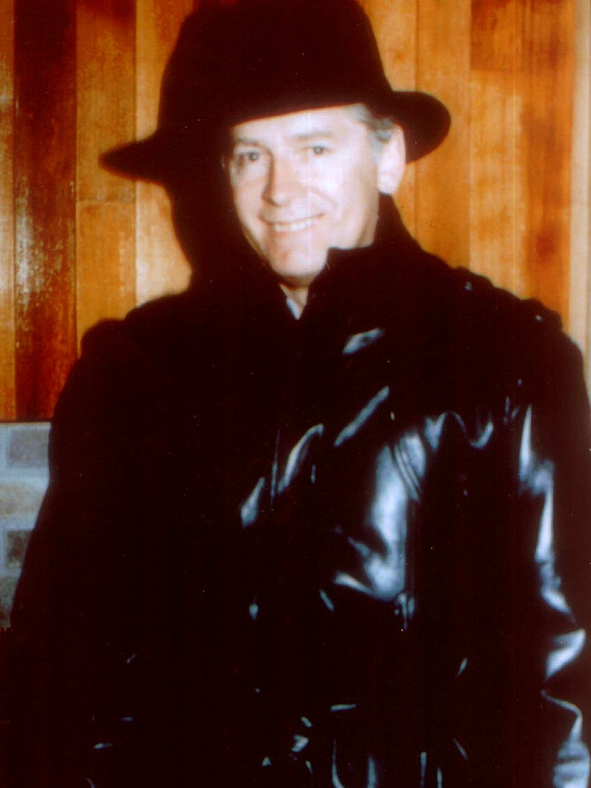 James 'Whitey' Bulger with hat and leather trench coat, smiles in an undated photo.