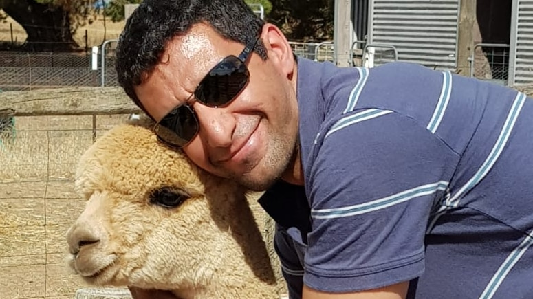 Play Audio. Canberra industrial engineer Babak Zendehdel embraces one of his pet alpacas.. Duration: 9 minutes 41 seconds