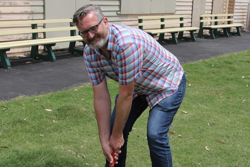Justin Mansfield prepares to hit a ring in a game of Trugo at Footscray Trugo Club.