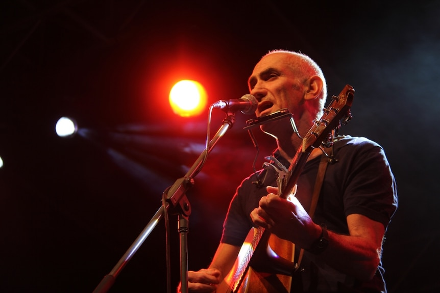 Paul Kelly performing at the Australian Stockman's Hall of Fame in Longreach.