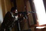Syrian rebel takes aim