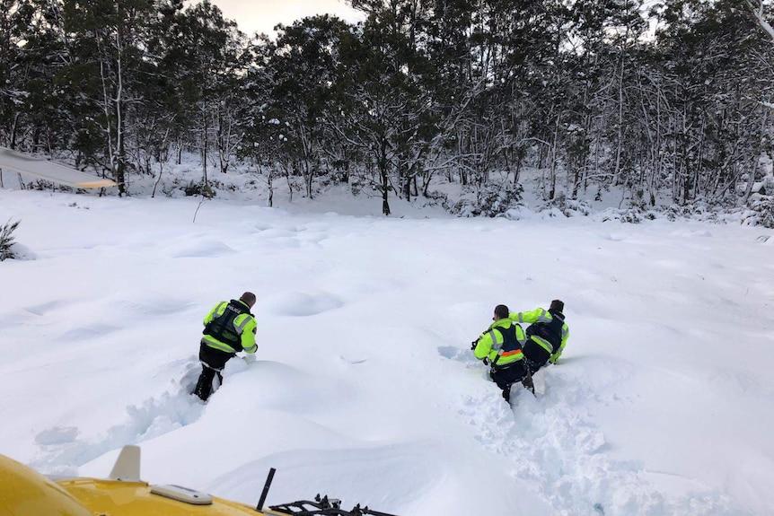 Police rescue team walks through snow in Lake St Clair area
