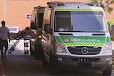 Two ambulances line up outside hospital entrance