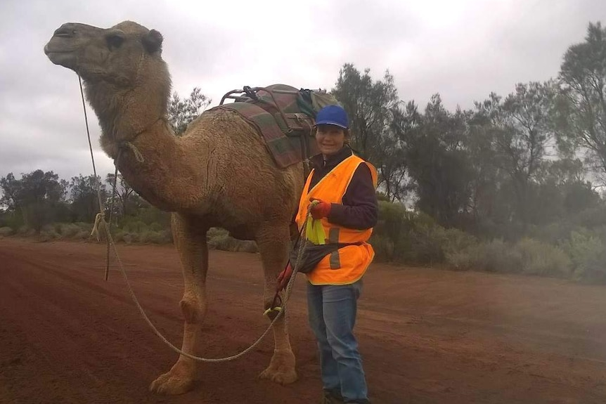 Image of Warri the camel and explorer Vicki Warburton on an isolated country road.