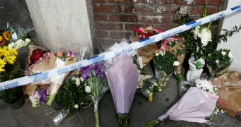 Flowers site behind police tape at a London Bridge attack memorial.