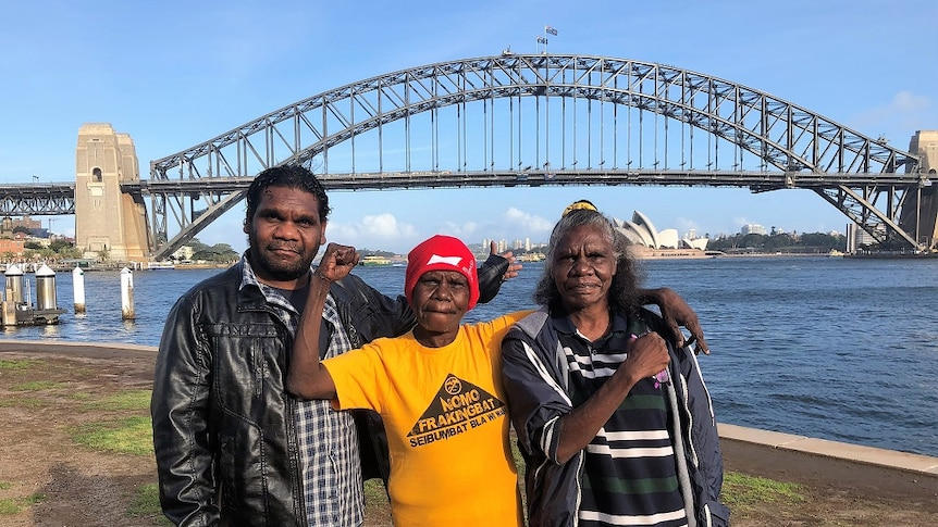 The three stand by the Sydney Harbour Bridge