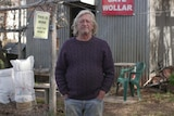 Col Faulkner standing outside his house