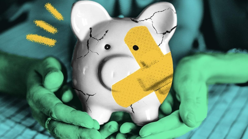 A cracked piggy bank patched up with band aids is held in a woman's hands, to depict a financial crisis and tips to fix it.