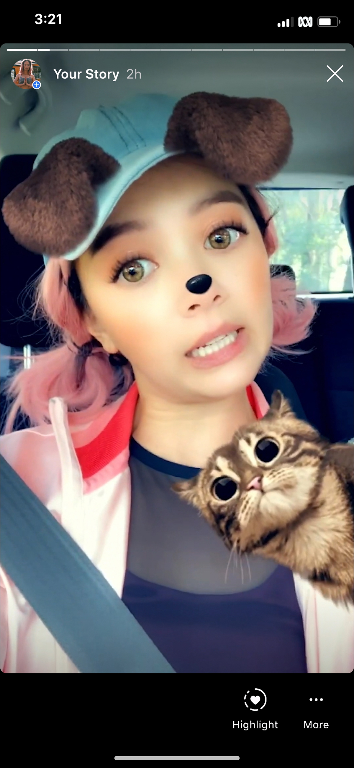 A screenshot of a woman sitting in car and posing in selfie mode with Instagram filters on top of face.
