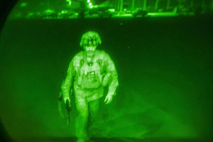 A US soldier seen through a night sight.