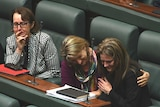 Victorian Labor MPs Judith Graley, Vicki Ward and Sonya Kilkenny clap and cry in Parliament.