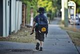 A primary school child (Yeronga State School) walking to School.