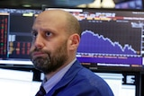 Trader Meric Greenbaum looks concerned as he watches the Bloomberg monitors at the New York Stock Exchange.