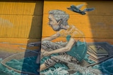 Russian artist Rustam Qbic's work above the library entrance.