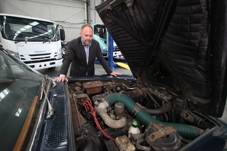 Tony Fairweather inspects the engine bay on the 1971 Rolls-Royce Silver Shadow.