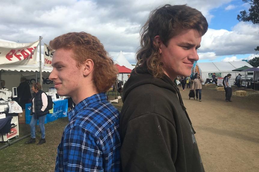 Two men wearing mullets.