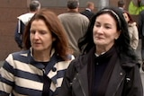 Rebecca Taylor, right, leaves an IBAC hearing in Melbourne with an unidentified woman.