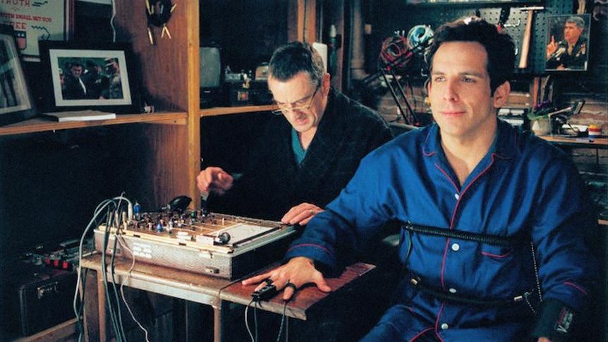 A still from the film Meet the Parents, showing Ben Stiller hooked up to a lie detector operated by Robert De Niro.