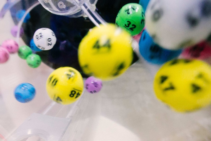 Numbered lottery balls mid-air.