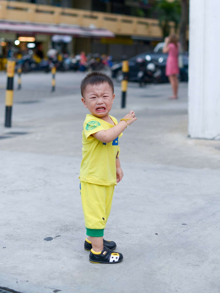 A Singaporean toddler throwing a tantrum.