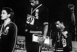 Tommie Smith (C) and John Carlos (R) raise their gloved fists