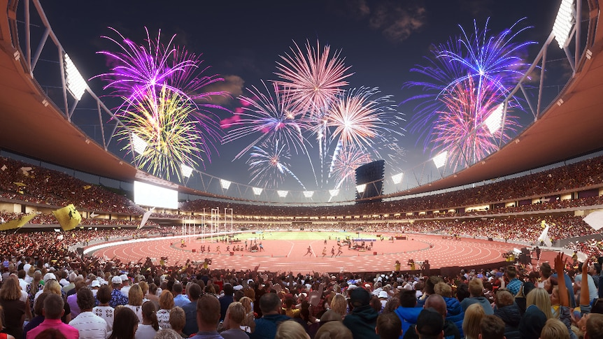 The inside of the stadium showing crowds, people on the field and fireworks.