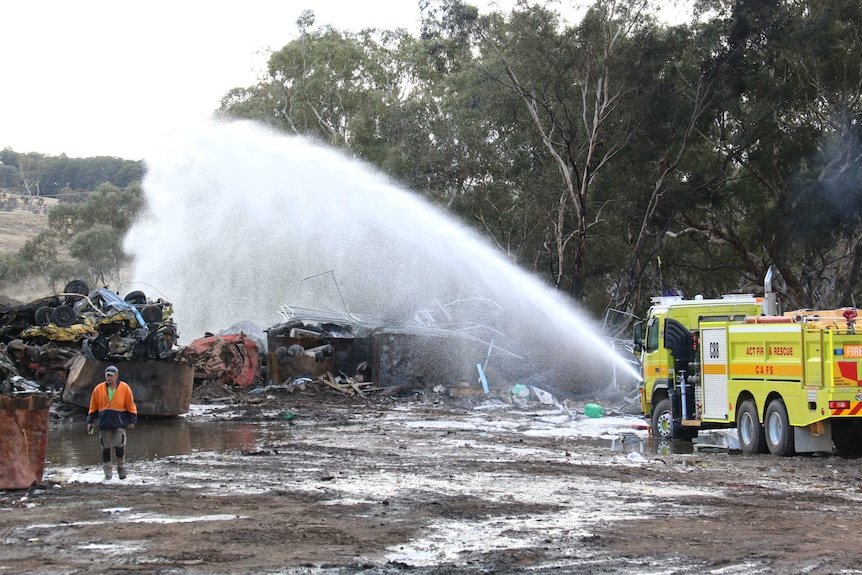 Water from a fire truck is sprayed on a burnt-out structure in Beard.