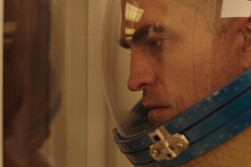 The actor Robert Pattinson in a space helmet in the film High Life