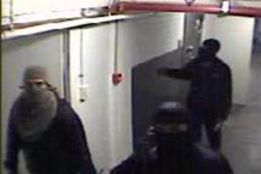 Security camera footage of the thieves responsible for the prescription drug heist.