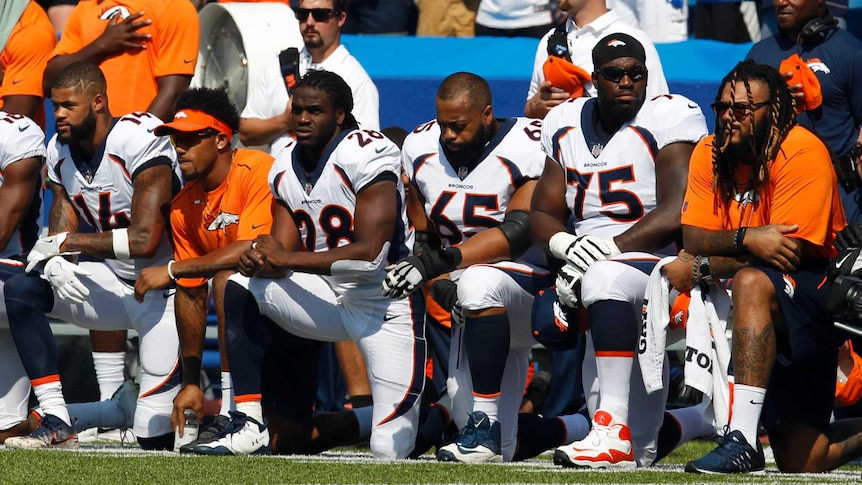 NFL players kneel during US anthem (Photo: Reuters)