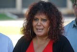 NT's Labor Senator Malarndirri McCarthy is talking to the camera with a serious expression.