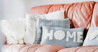 'Home' cushion on the sofa