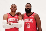 Two basketball players pose for a photograph