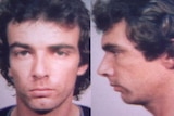 Mugshot of a young man with brown curly hair.