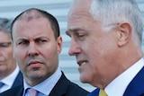 Josh Frydenberg looks at Malcolm Turnbull