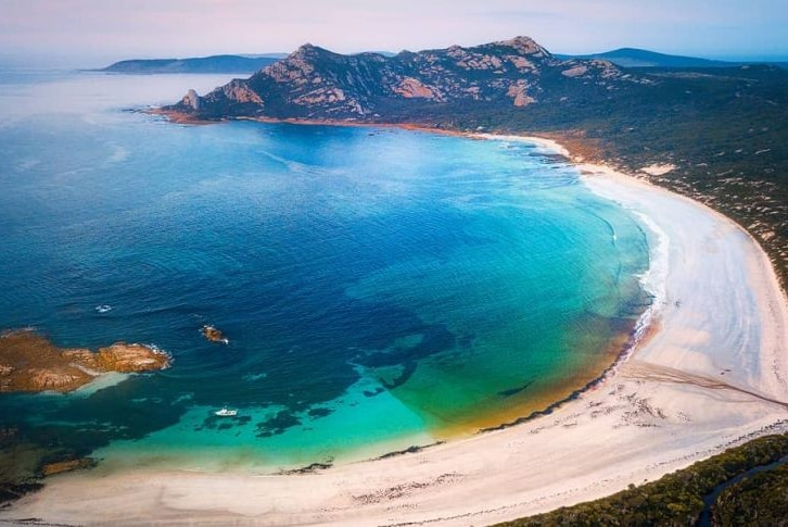 Aerial picture of a very picturesque bay with beautiful blue water on Flinders Island Tasmania