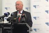 Bruce Lander speaks at a press conference in Adelaide.