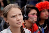 Sixteen year-old Swedish climate activist Greta Thunberg listens to speakers during a climate change demonstration.