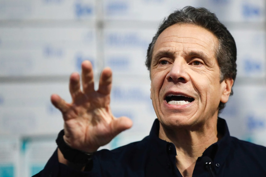 New York Governor Andrew Cuomo gestures with his hand while speaking