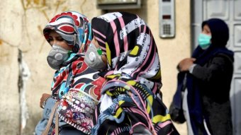 People where masks to help guard against the coronavirus in downtown Tehran, Iran.
