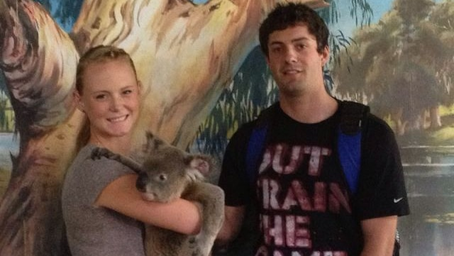 Christopher Lane with girlfriend Sarah Harper, holding a koala