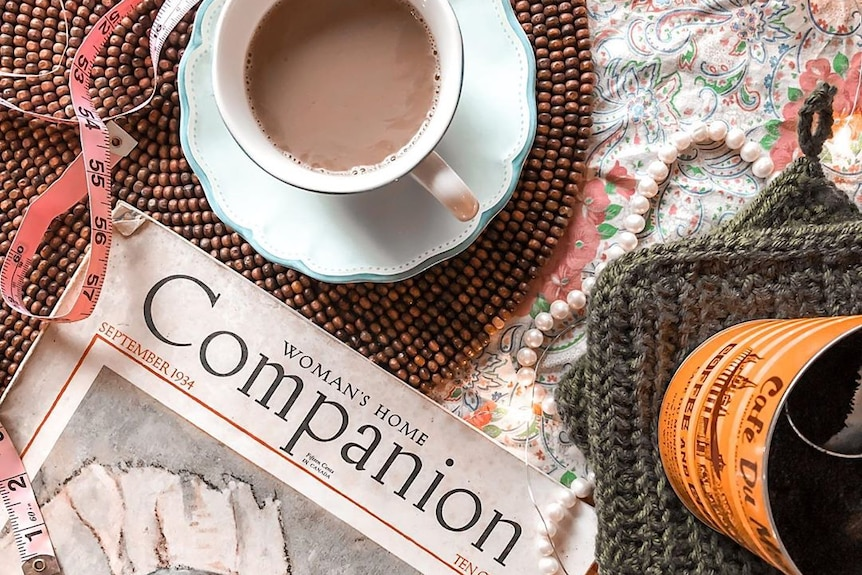 A cup of tea, measuring tape and a copy of Woman's Home Companion sits on Danielle's coffee table.