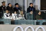 Diplomats watch the closing ceremony