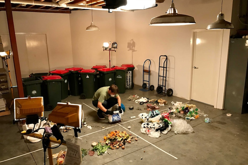 War on Waste Craig Reucassel sorting rubbish during filming of the program in 2017.