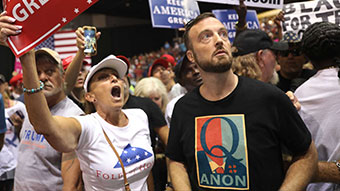 Man wearing QAnon t-shirt at rally.