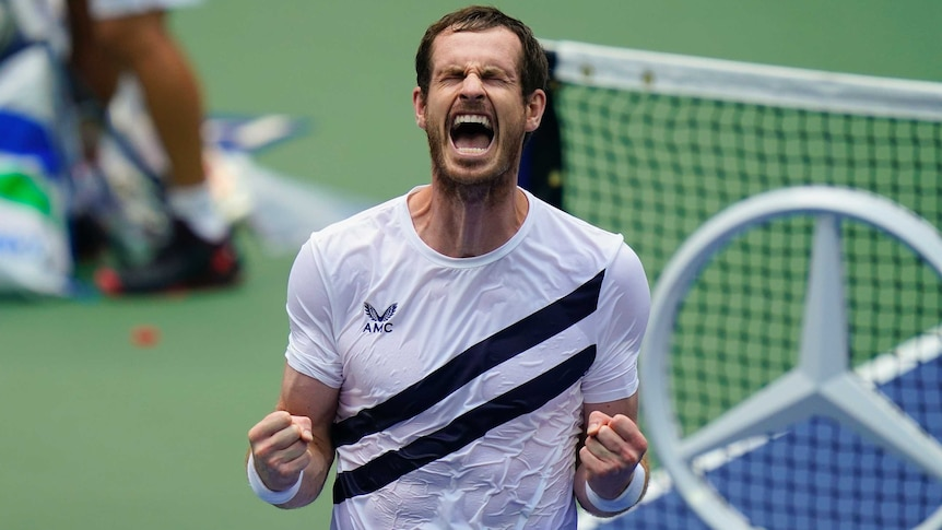 A tennis player closes his eye and roars in relief after winning a five-setter at the US Open.