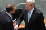 Tony Abbott shakes hands with Kevin Rudd.
